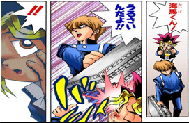 Kaiba hits Yugi with his briefcase.